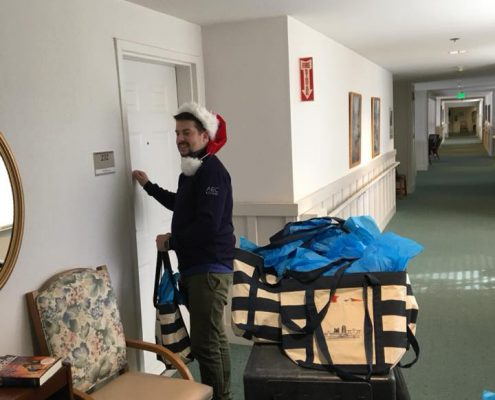 Stephen delivering gifts
