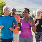 Multiethnic middle aged friends exercising together outdoor.
